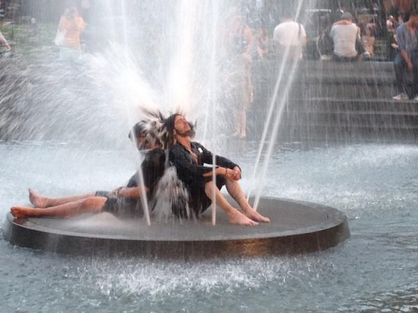 men in fountain